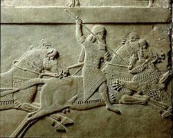 Ашшурбанипал охотится на льва (барельеф из Ниневии)